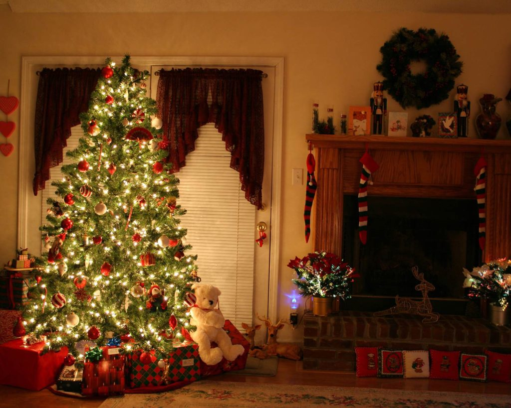Decorated Christmas tree in a home with presents underneath